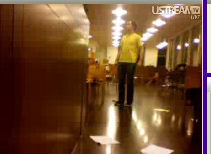 """According to Eisenhood, this shot is """"a terribly blurry screen grab of me from the live stream [that the student protest group] had running during the occupation."""""""